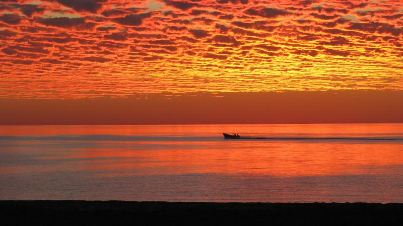 Fishermen in ponga heading out at sunrise from Campo Uno in San Felipe.